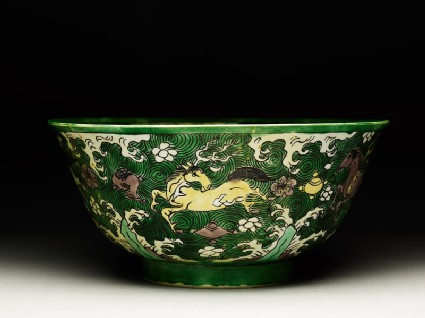 Bowl with horses amid waves