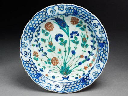 Dish with bouquet of flowers