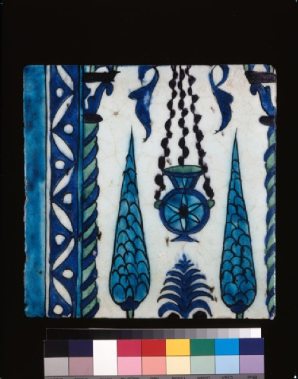 Square border tile with lamp and cypresses