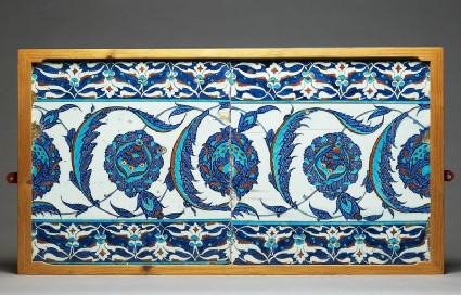 Tile decorated with peonies and serrated leaves