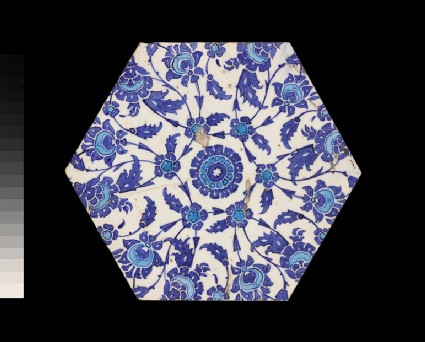 Hexagonal tile with floral decoration