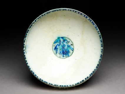 Bowl with duck beneath a tree