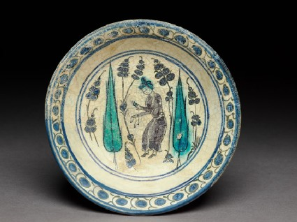 Saucer with turbaned figure between two cypress trees