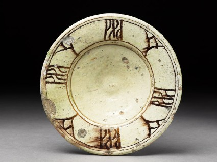 Plate with incised decoration