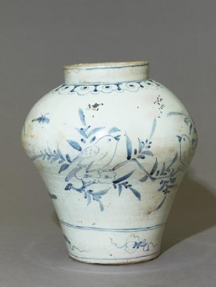 Jar with a bird on a prunus spray