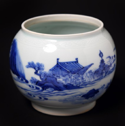 Blue-and-white bowl with figure lying beneath a tree