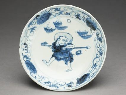 Dish with haloed monk