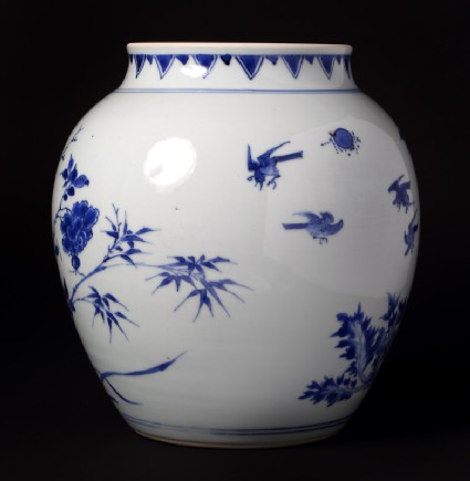 Blue-and-white jar with birds, rocks, and flowering branches