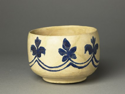 Mortar-shaped bowl with vegetal decoration
