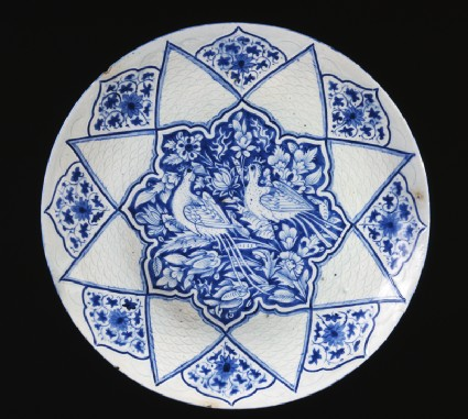 Dish with pheasants amid foliage
