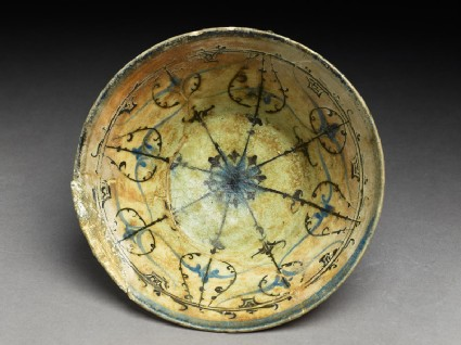Bowl with rosette and radiating bands