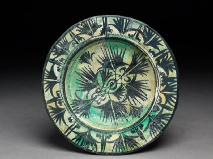 Dish with papyrus plants and leaves