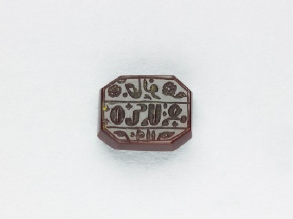 Octagonal bezel seal with Armenian inscription, cross, leaf, and floral decoration