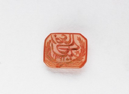 Octagonal bezel seal with nasta'liq inscription, garland, and a star
