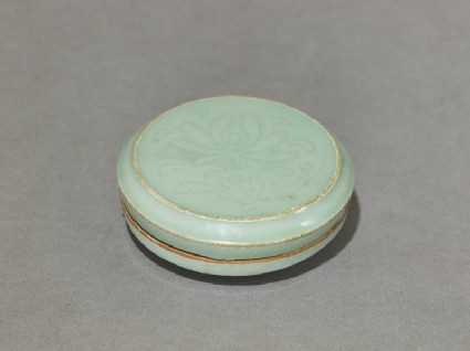 Circular greenware box with lotus flowers