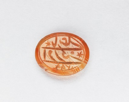 Oval bezel seal with inscription in cursive script and six-pointed stars