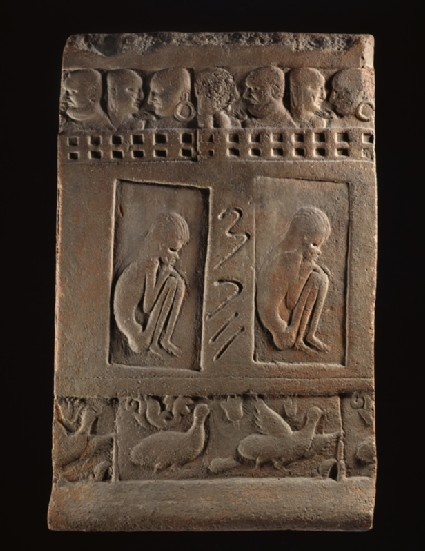 Terracotta tile with two ascetic figures