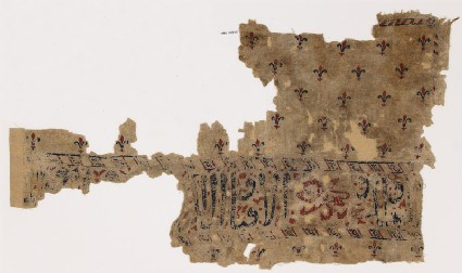 Textile fragment with inscription, lion, and lozenges