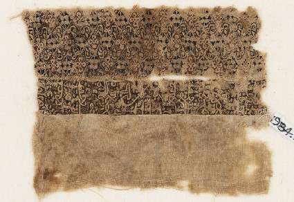 Textile fragment with quatrefoils and interlacing kufic script