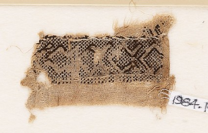 Textile fragment with hooked chevrons