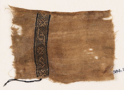 Textile fragment with lozenges, stars, and an S-shape