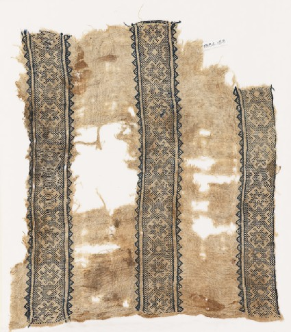 Textile fragment with bands of crosses, diamond-shapes, and arrows