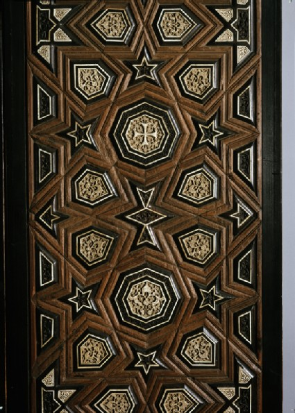 Door with geometric insets