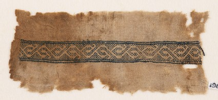 Textile fragment with stylized vine