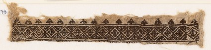 Textile fragment with diamond-shapes and floral quatrefoils, probably from a garment