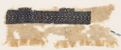 Textile fragment with linked diamond-shapes and arrows