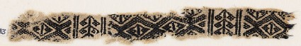 Textile fragment with linked-diamond shapes and stylized plants
