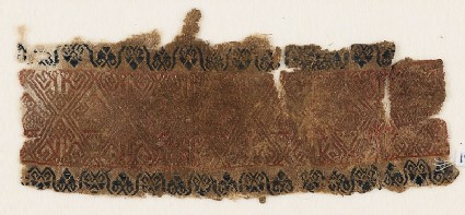 Textile fragment with linked diamond-shapes and possibly birds
