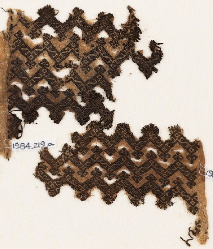 Textile fragment with chevrons and linked S-shapes and Z-shapes