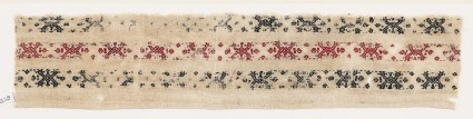 Textile fragment with bands of V-shapes and diamond-shapes