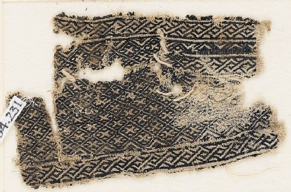 Textile fragment with grid of diamond-shapes