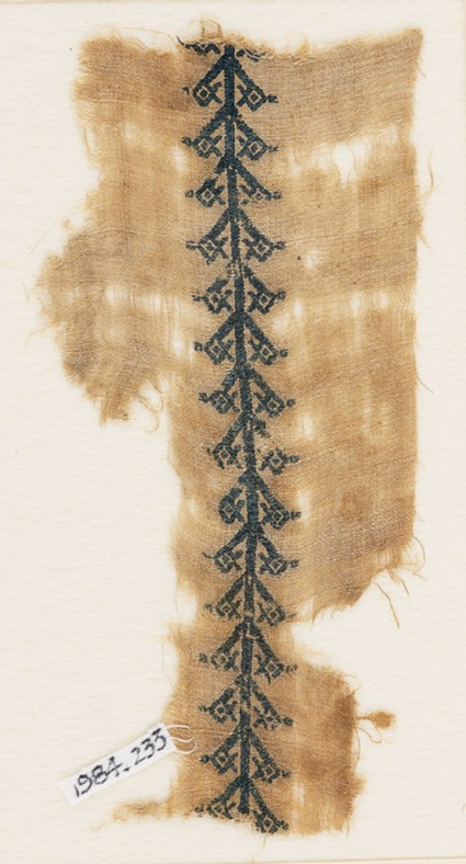 Textile fragment with pole and stylized flowers