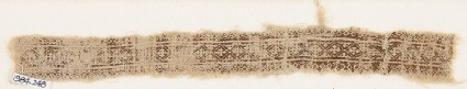 Textile fragment with linked diamond-shapes and quatrefoils