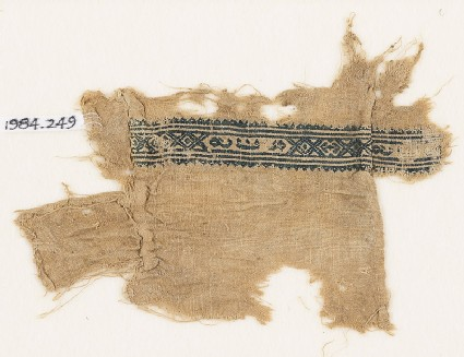 Textile fragment with hexagons, inscription, and diamond-shapes