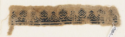 Textile fragment with triangles, inscription, diamond-shapes, and crescents