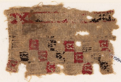 Textile fragment with squares and pseudo-inscription