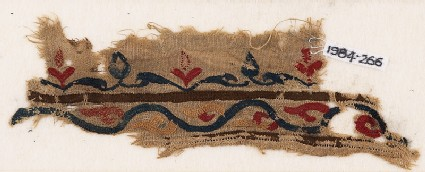 Textile fragment with vine and leaves