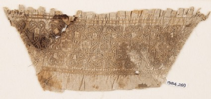 Textile fragment from a sleeve, with interlace, linked stars, and rosettes