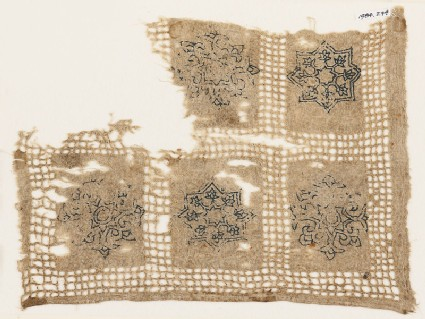 Textile fragment with interlace rosettes, stars, and flowers
