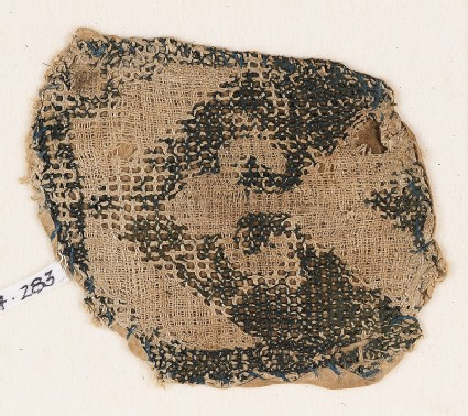 Textile fragment with chevron and trefoil peak