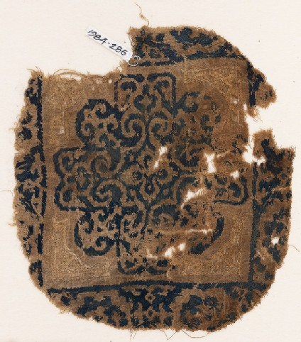 Textile fragment with rosette and scrolls
