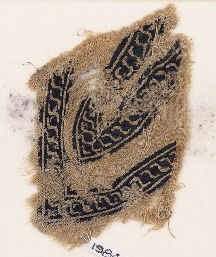 Textile fragment with linked scrolls of S-shapes, possibly from a garment