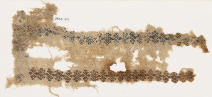 Textile fragment with linked hooks and stylized leaves