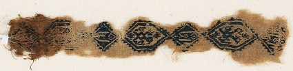 Textile fragment with two-headed birds and inscription