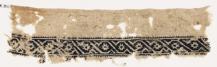 Textile fragment with scroll of linked S-shapes and rosettes