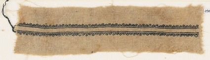 Textile fragment with triangles and stylized flowers